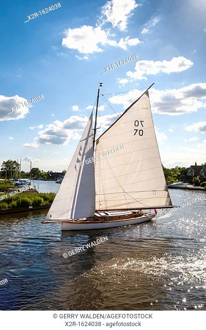 Gaff rigged sloop under sail on the river at Horning in Norfolk, England