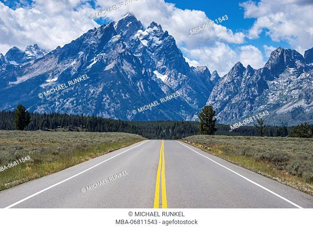 Road leading in the Teton range in the Grand Teton National Park, Wyoming, USA
