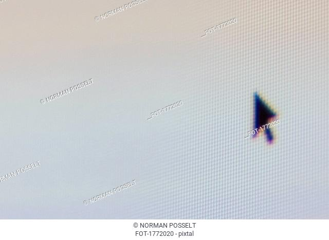 Close up computer mouse cursor on screen