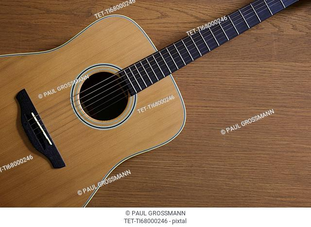 Acoustic guitar lying on floor