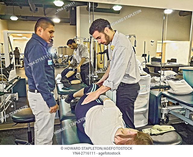 Physical Therapists check on a patient following knee replacement surgery