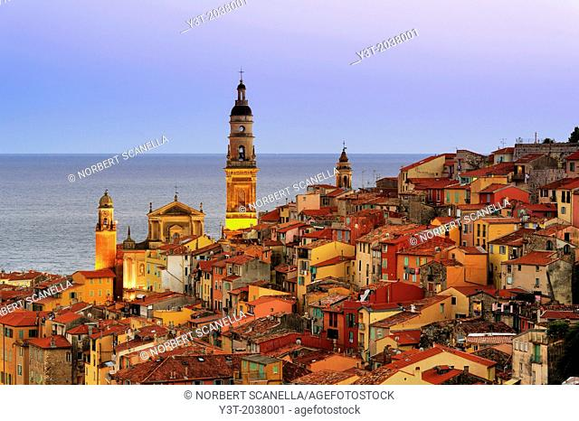 Europe, France, Alpes-Maritimes, Menton. The old town, and the Basilica of Saint Michel at twilight
