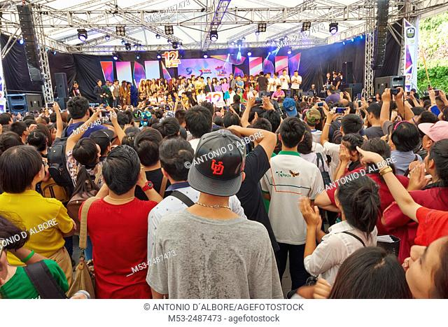 A large group of people listening to pop singers participating at a public show organized to celebrate the 12th anniversary of the media company Nine Entertain...