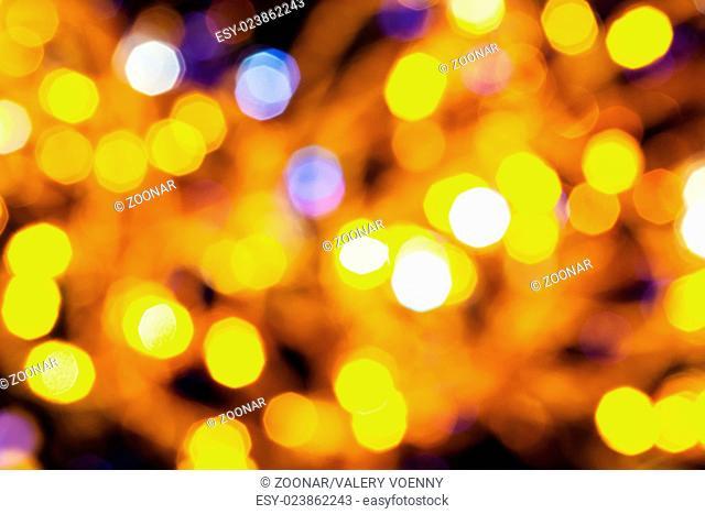 dark yellow and violet twinkling Christmas lights