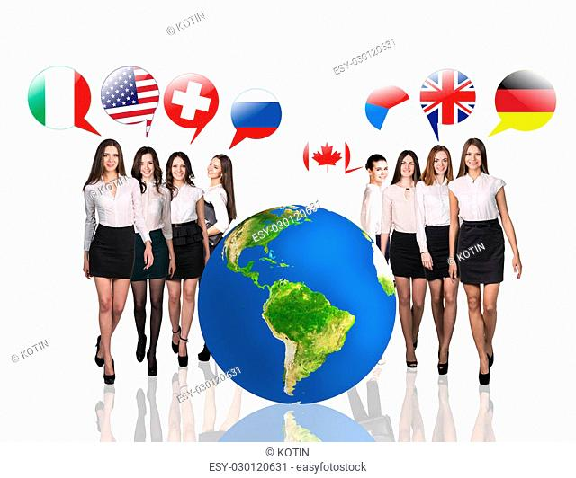 Business women near big earth and flag bubbles.Elements of this image furnished by NASA