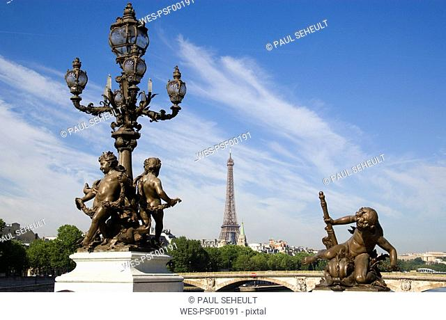 France, Paris, Pont Alexandre III, Bronze statues, Eiffel Tower in background