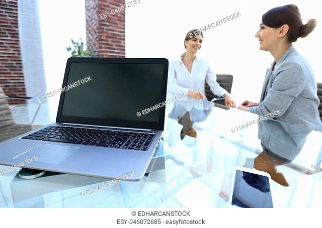 laptop and a smartphone on the desktop of a businessman. workplace