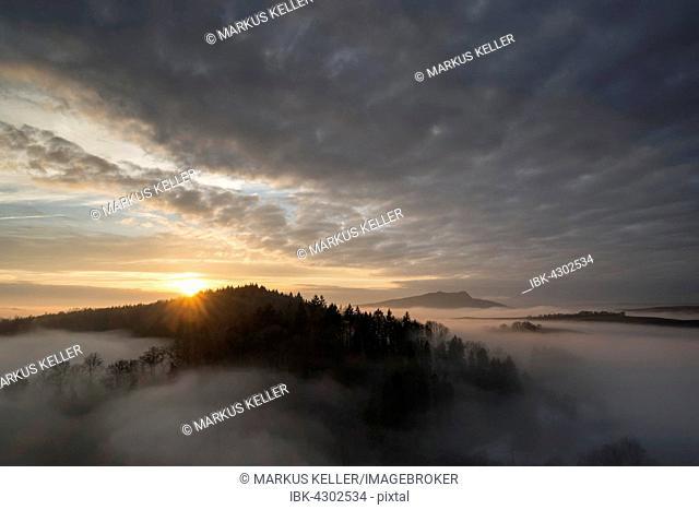 Sunset over volcanic landscape with fog, Konstanz district, Baden-Württemberg, Germany