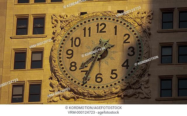 STATIC LOCKED DOWN TIME LAPSE LONG SHOT SUNRISE PUBLIC CLOCK METROPOLITAN LIFE COMPANY TOWER MANHATTAN NEW YORK CITY USA