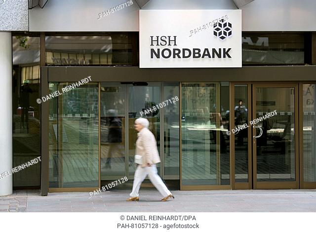 A walks past a branch of the HSHNordbank in Hamburg, Germany, 9 June 2016. The bank presented its annual balance for 2015 at a press conference on the same day