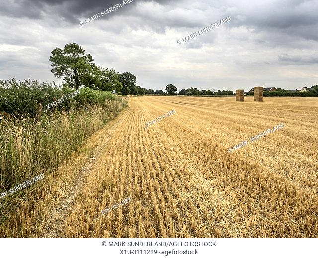 Stubble and straw bales in a recently harvested field near Knaressborough North Yorkshire England