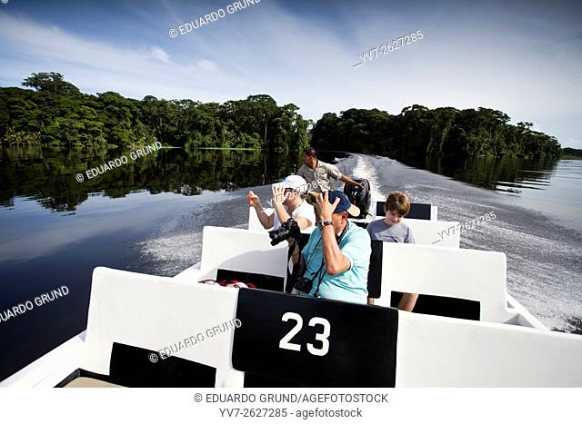 Tourists on the canals of Tortuguero National Park, enjoying a Tour watching wildlife. Tortuguero, Costa Rica, Central America