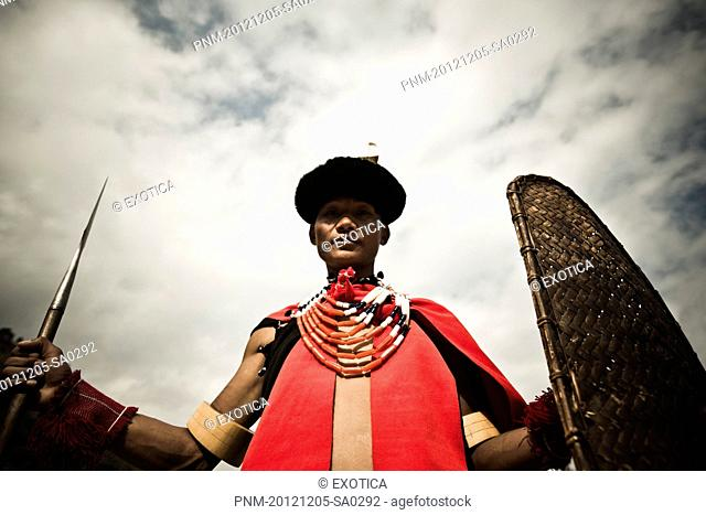 Naga tribal warrior in traditional outfit with spear and shield, Hornbill Festival, Kohima, Nagaland, India
