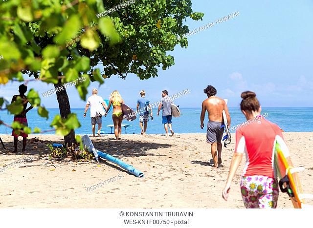 Indonesia, Bali, surfers walking to the ocean