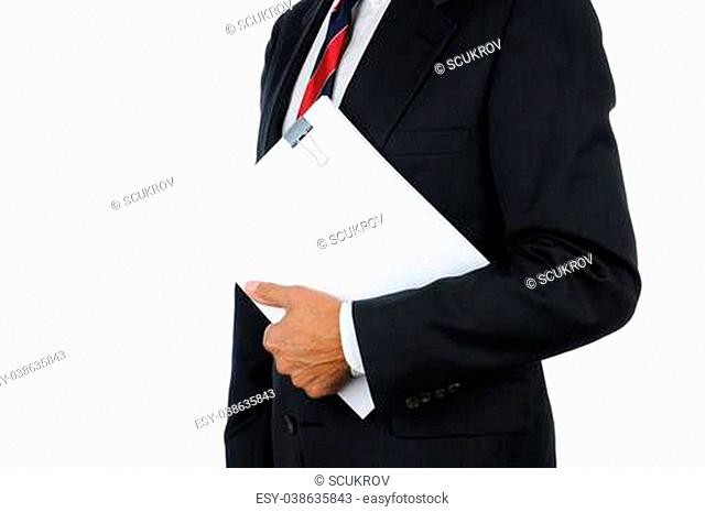 Close up of a businessman holding a ream of clipped together documents, Horizontal format showing torso only isolated on white