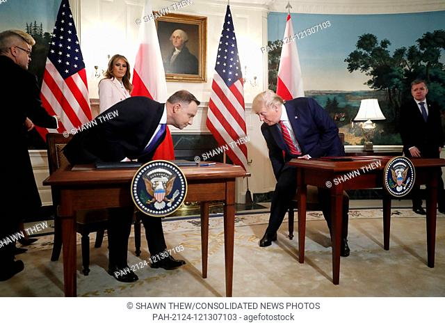 US President Donald J. Trump (R) and Polish President Andrzej Duda (L) arrive to participate in a signing ceremony in the Diplomatic Reception Room of the White...