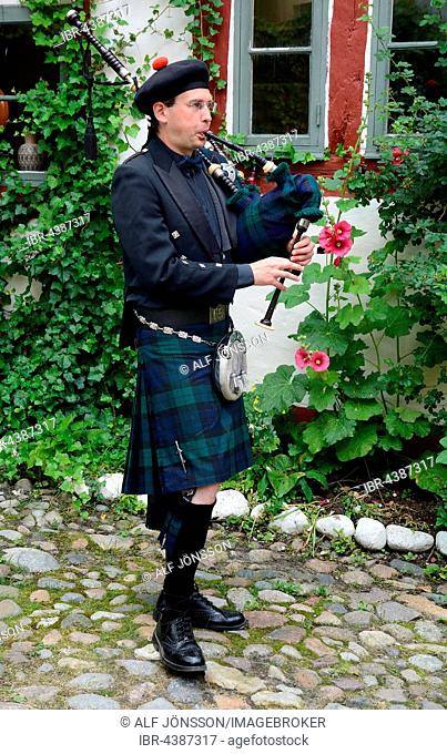 Swedish musician plays bagpipe , Ystad, Scania, Sweden