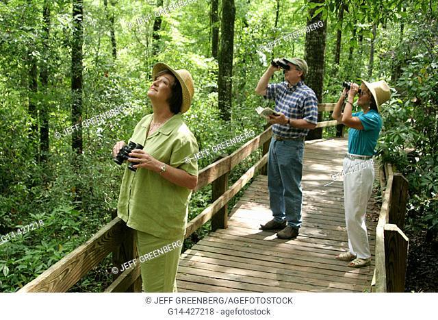 Landmark Park, nature boardwalk, birdwatchers, trees. Dothan, Alabama. USA