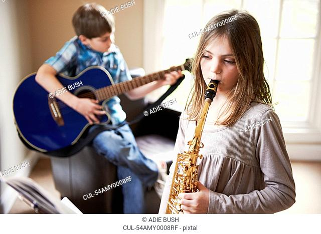 Children playing music together