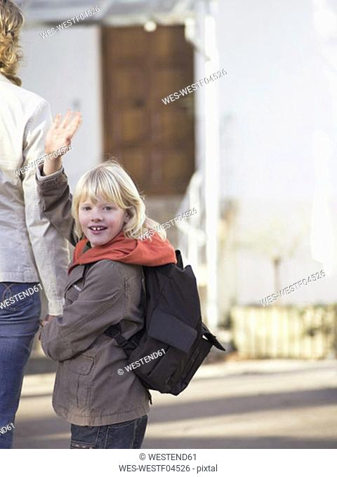 Mother bringing boy to school