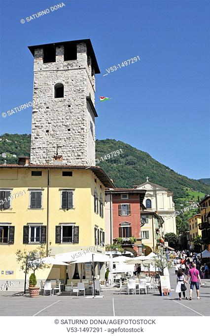 torre del vescovo tower and central square in Pisogne - Lake of Iseo - Lombardy - Italy