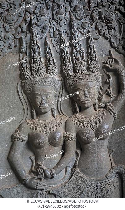 Aspara sculptures in bas-relief on the wall, in Angkor Wat, Siem Reap, Cambodia