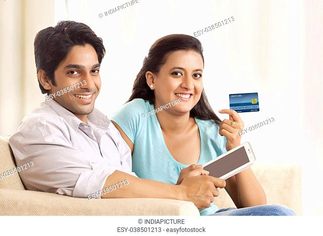 Happy Couple Shopping Online using mobile