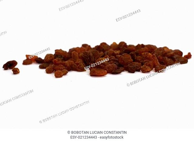 Dried raisins over white background