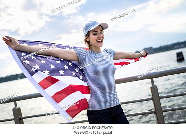 Happy woman with American flag