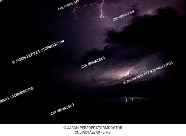 A night time tornadic thunderstorm generating multiple types of lightning