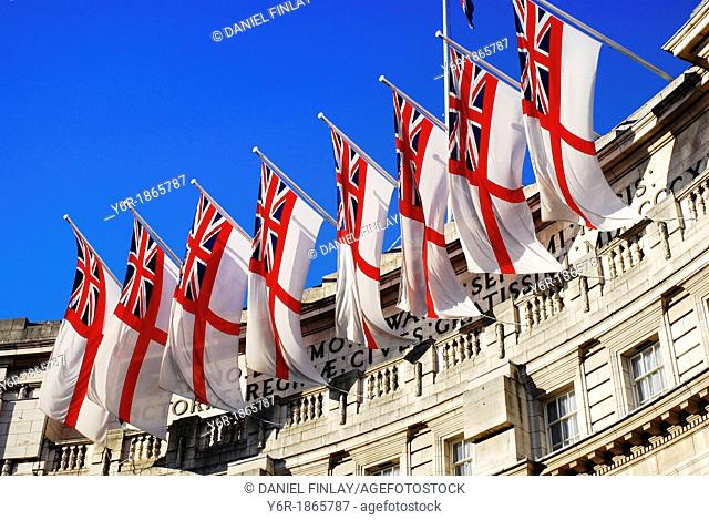 British naval flags on Admiralty Arch, on the opposite end of The Mall from Buckingham Palace, on a sunny day in London, England