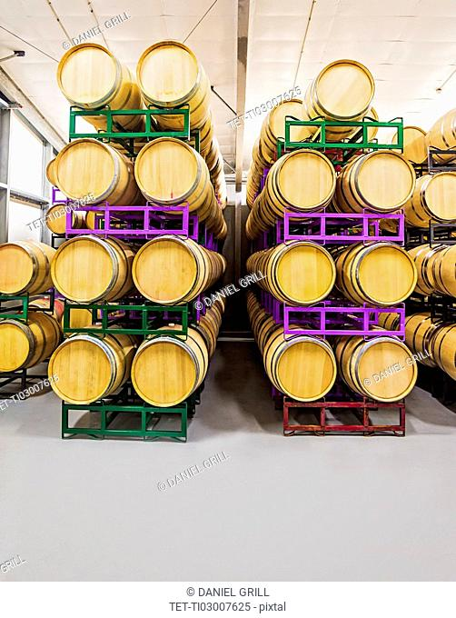 Wine barrels on racks in cellar