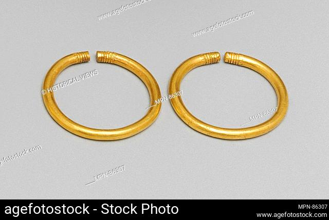 Gilded bronze bracelet. Date: 6th-5th century B.C; Culture: Greek, Cypriot; Medium: Gold, bronze; Dimensions: Overall: 2 1/16 x 3/16 in. (5.2 x 0