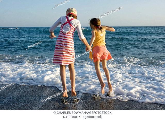 girl children on beach 2 sisters