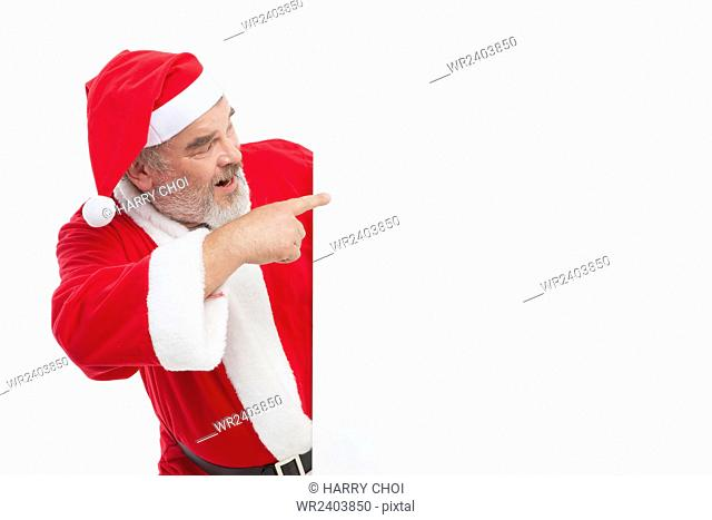 Side view portrait of Santa pointing to something