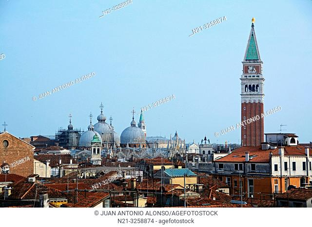 Partial view of the city of Venice with the domes of the Basilica di San Marco and beyond, the tower of San Giorgio Maggiore