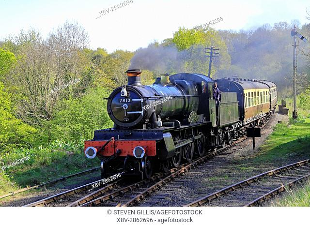 Steam locomotive No. 7812 Erlestoke Manor approaching Highley Railway Station on the Severn Valley Railway near Bridgnorth, Shropshire, England, UK