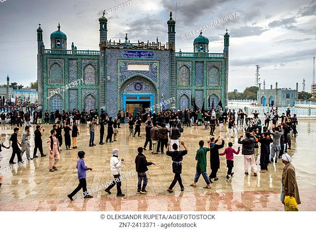 People gathering in the Shrine of Ali on Day of Ashura, tenth day of Muharram and commemoration of Husayn ibn Ali's death, Mazar-i Sharif, Afghanistan