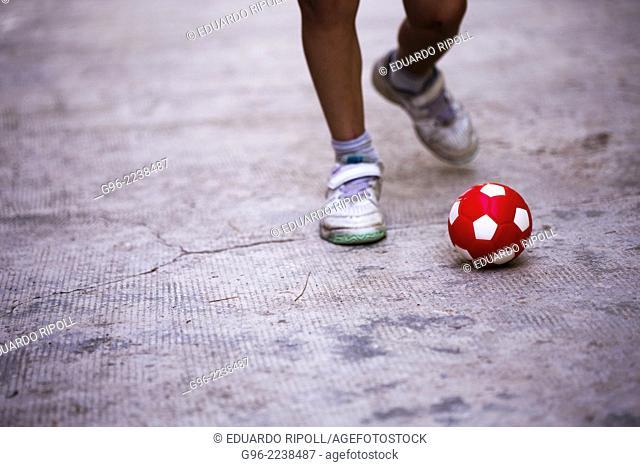 a boy shooting a ball