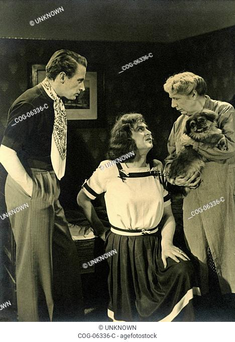 Scene from an unidentified movie with a man dressed as a woman