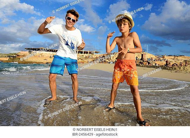 Two boys rapping on the beach in front of Cala Comte, Platges de Comte, Ibiza, Pitiusic Islands or Pine Islands, Balearic Islands, Spain, Europe