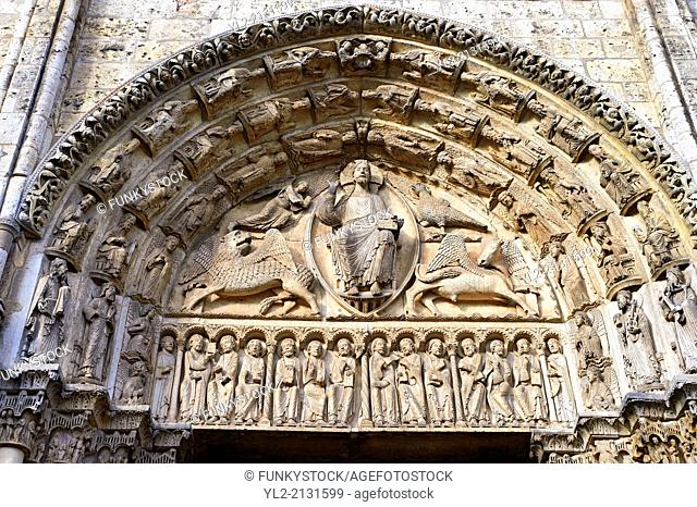 West Facade, Central Portal Tympanum - General View c. 1145. Cathedral of Chartres, France . The tympanum shows gothic sculptures of Christ in Majesty...