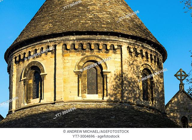 Golden evening light on Grade 1 listed 12th-century medieval Round Church of Holy Sepulchre Cambridge Cambridgeshire England