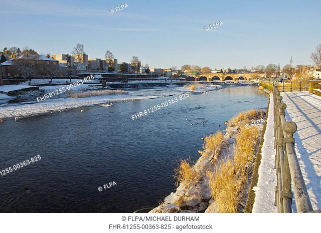 View of partially frozen river and bridge, River Nith, Dumfries, Dumfries and Galloway, Scotland, december