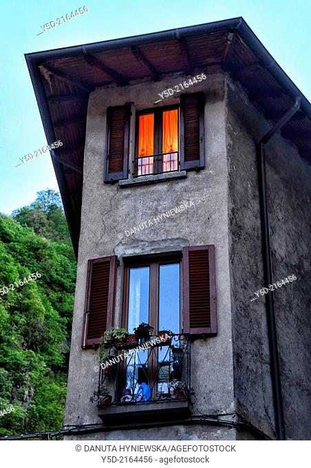 light in house window, historic part of Porlezza, Province of Como, Lombardy, Italy
