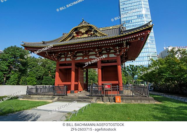 Tokyo Japan gate of Zojo-ji Temple in Shiba neighborhood in downtown city view red historical monument