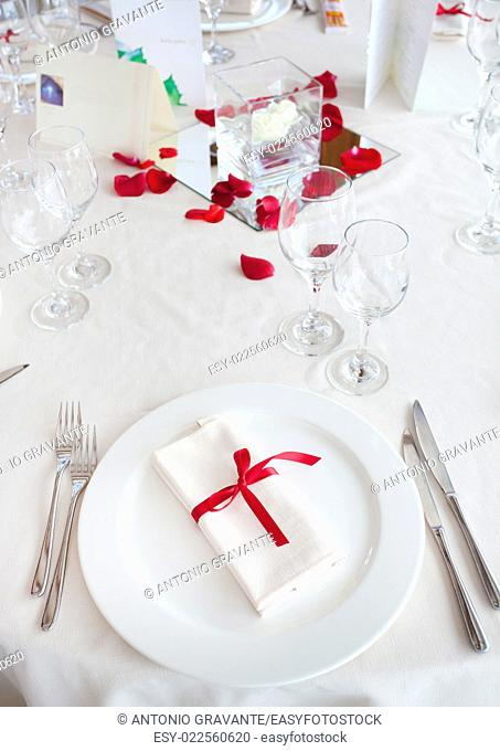 Table set for a Wedding reception with red decorations