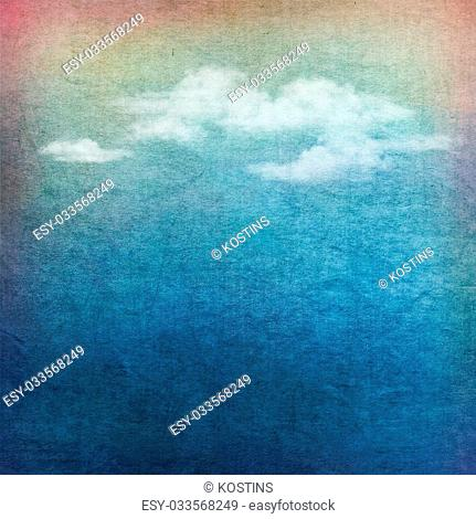Vintage sky background with white clouds on fabric texture
