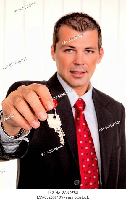 Successful real estate broker with a house key