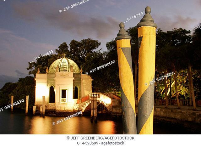 Vizcaya Museum and Gardens, Renaissance Italianate 1910, striped poles, gazebo, dusk. Biscayne Bay. Miami. Florida. USA